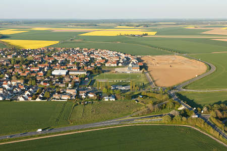 Aerial photograph of Ablis and rapeseed fields in spring, located in the south of the Yvelines department, ÃŽle-de-France region, France.