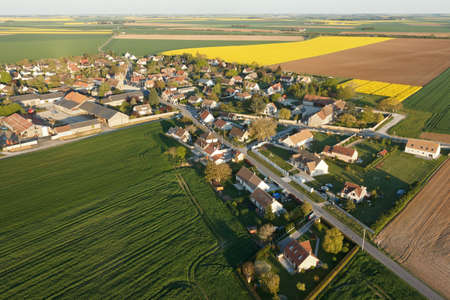 Aerial photograph of Boinville-le-Gaillard and rapeseed fields, located in the south of the Yvelines department, ÃŽle-de-France region, France. Municipality of the natural Beauce bordering Ablis.