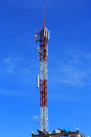 antennas of cellular communication on the blue sky background    photo