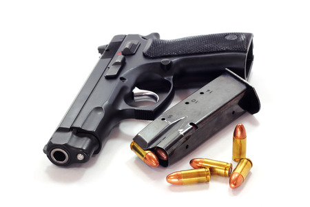 Pistol and  bullets on white background 写真素材