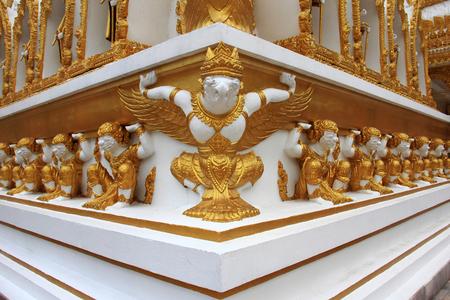 Golden  Garuda  and Golden Giants  statue on  wall   Stock Photo - 22575038