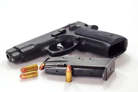 Pistol and  bullets on white background Standard-Bild