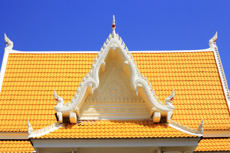 Thai style molding  art  on  pediment  Thai  temple photo