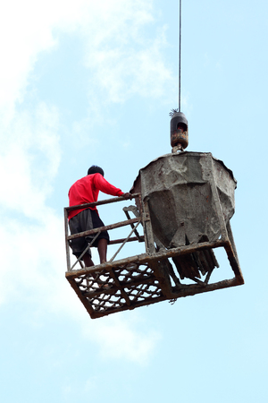 worker working with crane on construction site photo