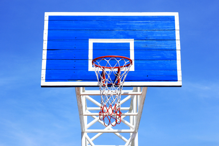Basketball board with  hoop on blue sky background  photo