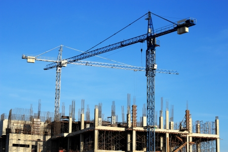 Construction site with crane on  blue sky background   photo