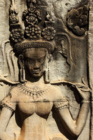 handscraft: Stone ancient Apsara engraving on Angkor wat   Stock Photo