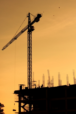 Construction site with crane on sunset background   photo
