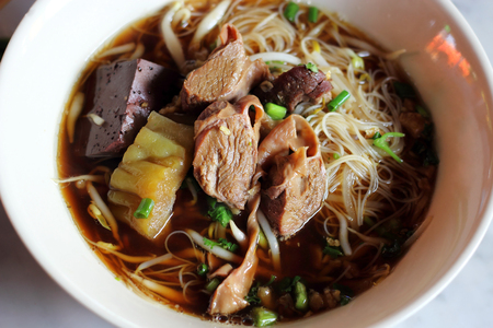 Thai food  rice noodle soup with meat   photo