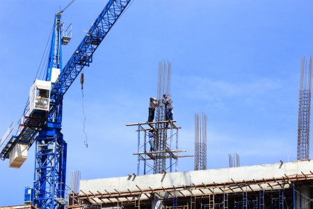 worker working  with crane  on construction  site