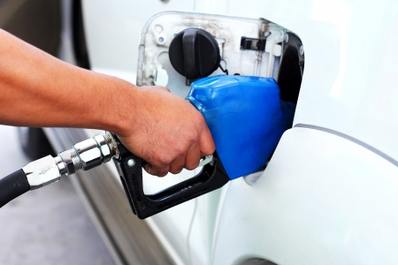 hand fill up fuel gas station