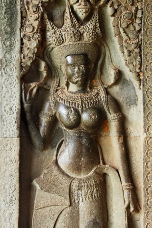 handscraft: Stone ancient Apsara engraving on Angkor wat   Editorial