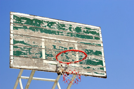 Old  basketball board with  hoop on blue sky background  photo