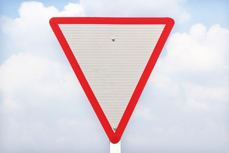 yield traffic sign on blue  sky background   photo