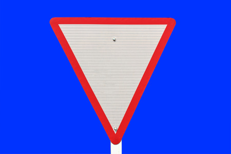 yield traffic sign on blue  background   photo