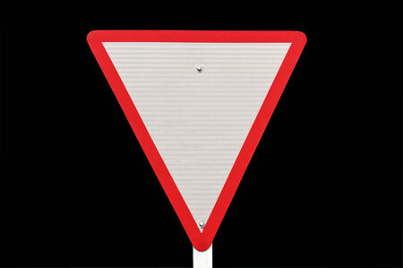 yield traffic sign  on  black background   photo