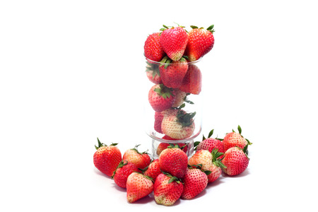 Fresh ripe strawberries in glass on white background photo