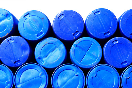 Blue plastic barrels containing chemicals  isolated on white  Standard-Bild