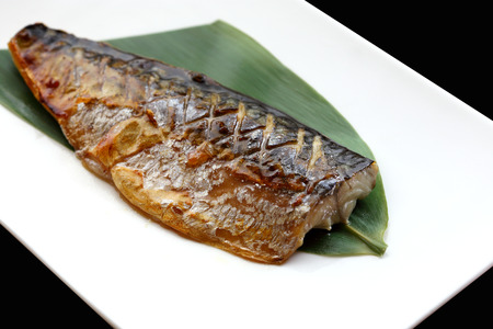 japanese cuisine saba fish grilled with sauce in the white plate photo