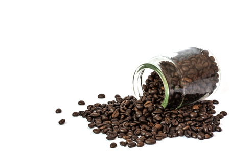 coffee beans spilling out glass bottle on white background  photo