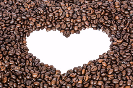 white heart shaped from coffee beans photo