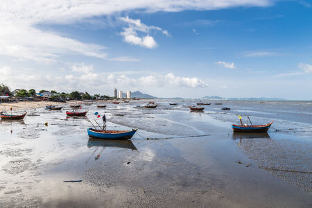 fishing boats on the beach mud photo