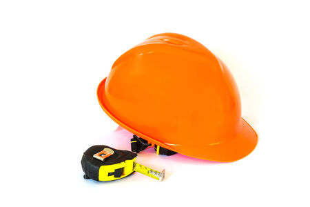 yellow safety helmet and tape measure on white background photo
