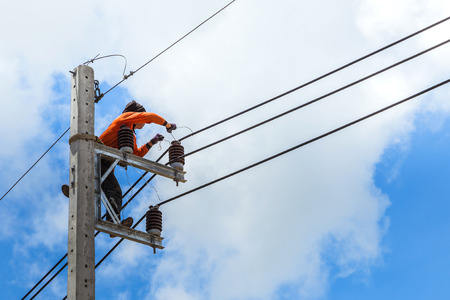 electrician repairing wire of the power line photo