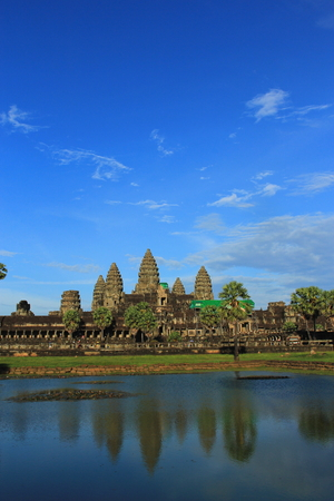 angkor wat reflection on the water in sunny day