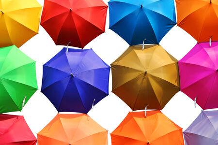 colorful umbrellas on white background photo