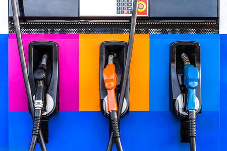 gas pump nozzles on service station Standard-Bild