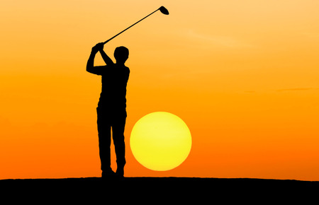 silhouette golfer playing golf on sunset photo
