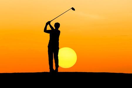 silhouette golfer playing golf on sunrise