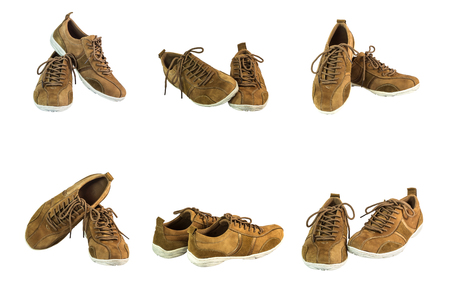 collection of brown suede leather shoes on white background