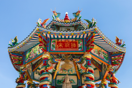 quan yin: chinese shrine in thailand on blue sky background