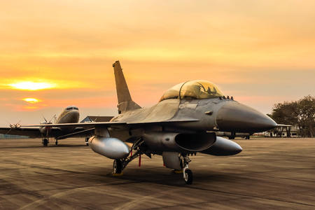 f16 falcon fighter jet on sunset  background Stock Photo