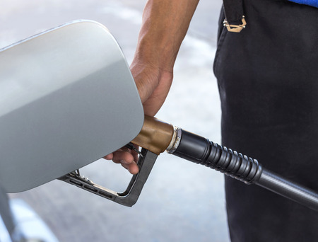 fill up: man fill up fuel gas on service station