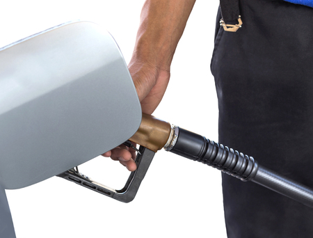 fill up: man hand fill up fuel gas on service station Stock Photo