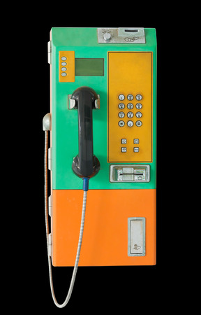cell phone booth: Old public telephone coin and card  on black background