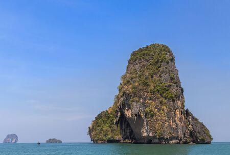 railay: Tropical sea with limestone rock and blue sky background at railay beach  krabi Thailand