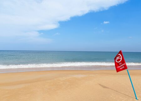 no swimming: warning red flag no swimming sign on the beach Stock Photo