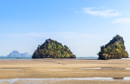 aonang: view of tropical beach and sea during low tide at noppharatthara  beach Krabi, Thailand. Stock Photo