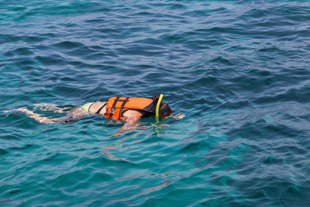 snorkelling: Woman snorkelling in clear tropical turquoise water at phi phi islands, Thailand