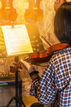 beethoven: young girl playing violin  in the music room. Stock Photo