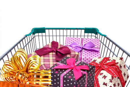 family mart: gifts and presents in shopping trolley cart isolated  on white background
