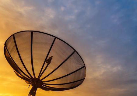 Satellite dish on sunrise background