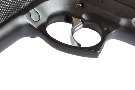 close up trigger pistol automatic weapon on white background