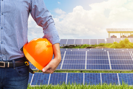 engineer stand holding yellow construction helmet front  solar photovoltaic  power station