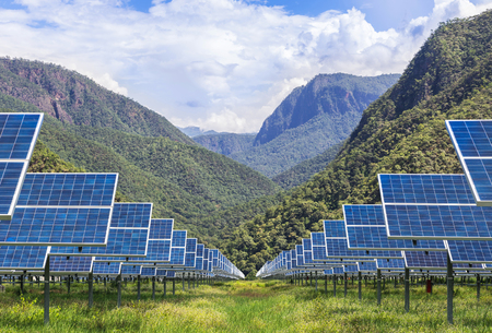 solar photovoltaics panels in solar power station  with mountains  background Reklamní fotografie - 65814932