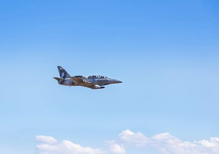 L-39 albatros fighter jet flying on sunset  background on white blue sky  background